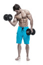 Muscular bodybuilder guy doing exercises with dumbbells isolated over white background Royalty Free Stock Photography