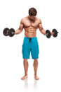 Muscular bodybuilder guy doing exercises with dumbbells over white background Royalty Free Stock Image
