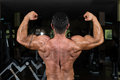 Muscular bodybuilder showing his back double biceps body builder Stock Photo