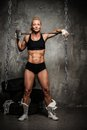 Muscular bodybuilder woman beautiful with a big hammer Stock Photo