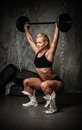 Muscular bodybuilder woman beautiful doing exercise with weights Royalty Free Stock Image