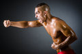 Muscular boxer in dark Royalty Free Stock Photos