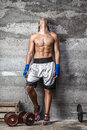 Muscular boxer man standing on the wall portrait of and looking up Royalty Free Stock Image