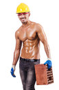 Muscular builder with bricks Royalty Free Stock Image