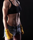 Muscular female torso black background Royalty Free Stock Photos