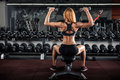 Muscular fitness woman doing exercises in the gym. Royalty Free Stock Photo