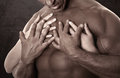 Muscular male body. Holding female hands Royalty Free Stock Photo