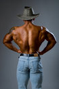 Muscular male hat man stands his back naked torso Royalty Free Stock Photography
