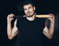 Muscular man with baseball bat on the ruins Stock Photos