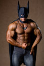 A muscular man in a Batman costume.