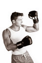 Muscular man boxing Royalty Free Stock Images