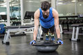 Muscular man doing push up with bosu ball Royalty Free Stock Photo
