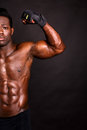 Muscular man flexing his biceps african model cropped image Stock Photography