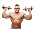 Muscular man handsome young exercising with dumbbells Royalty Free Stock Photo