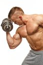 Muscular man handsome young exercising with dumbbells Royalty Free Stock Photography