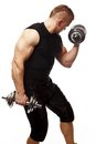 Muscular man handsome young exercising with dumbbells Stock Photos