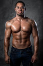 Muscular man handsome young studio shot Royalty Free Stock Images