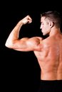 Muscular man isolated black background Royalty Free Stock Images