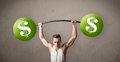 Muscular man lifting green dollar sign weights strong Royalty Free Stock Photography