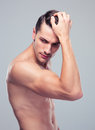 Muscular man posing over gray background Royalty Free Stock Photo