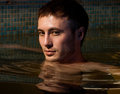 Muscular man posing in the swimming pool Stock Images