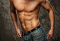 Muscular man s body in blue jeans Royalty Free Stock Images