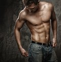 Muscular man s body young with in blue jeans Royalty Free Stock Photo