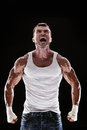 Muscular man screaming and roar Royalty Free Stock Photo
