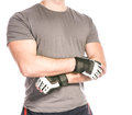 Muscular man in sports gloves isolated on white background high resolution Royalty Free Stock Photography