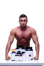 Muscular Man With Sports Nutrt...