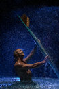 Muscular man and surfboard in water portrait of the under the rain Royalty Free Stock Photo