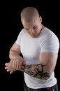 Muscular man with tattoo Stock Photos