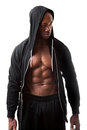 Muscular man wearing a hoodie toned and ripped lean muscle fitness hooded sweatshirt isolated over white background Royalty Free Stock Photo