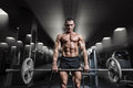 Muscular man workout with barbell at gym. Deadlift barbell work Royalty Free Stock Photo