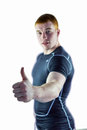 Muscular rugby player gesturing thumbs up Royalty Free Stock Photo