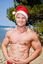 Muscular santa claus show in summer holiday Stock Photo