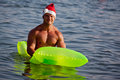 Muscular santa claus show in summer holiday Royalty Free Stock Photos
