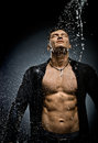 Muscular sexy guy the very handsome under shower naked torso Stock Images