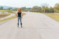 Muscular sporty young woman on roller blades Royalty Free Stock Photo