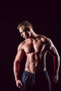 Muscular, strong and sexy man isolated on black background Royalty Free Stock Photo