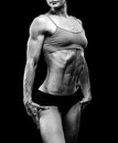 Muscular strong woman black background Royalty Free Stock Photos