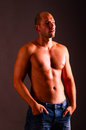 Muscular torso man in jeans with Stock Photo