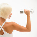 Muscular white fitness woman hold weights white Royalty Free Stock Photography