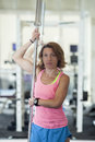 Muscular woman with barbell in gym Stock Photos