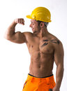 Muscular young construction worker shirtless looking at his bulging bicep isolated on white Royalty Free Stock Images