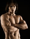 Muscular young man with arms crossed photo of an attractive no shirt posing his Royalty Free Stock Photos