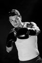 Muscular young man boxing Stock Image