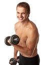 Muscular young man lifting a dumbbell Stock Image
