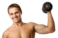 Muscular young man lifting a dumbbell Stock Photo