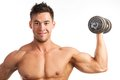 Muscular young man lifting a dumbbell Royalty Free Stock Photo